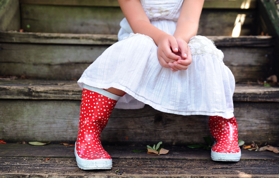 Red boots were used as a prop for a ft. lauderdale child photography session.
