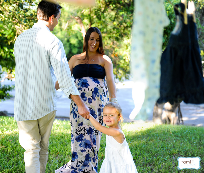 Family plays at the park for this beautiful maternity photo shoot in Miami.