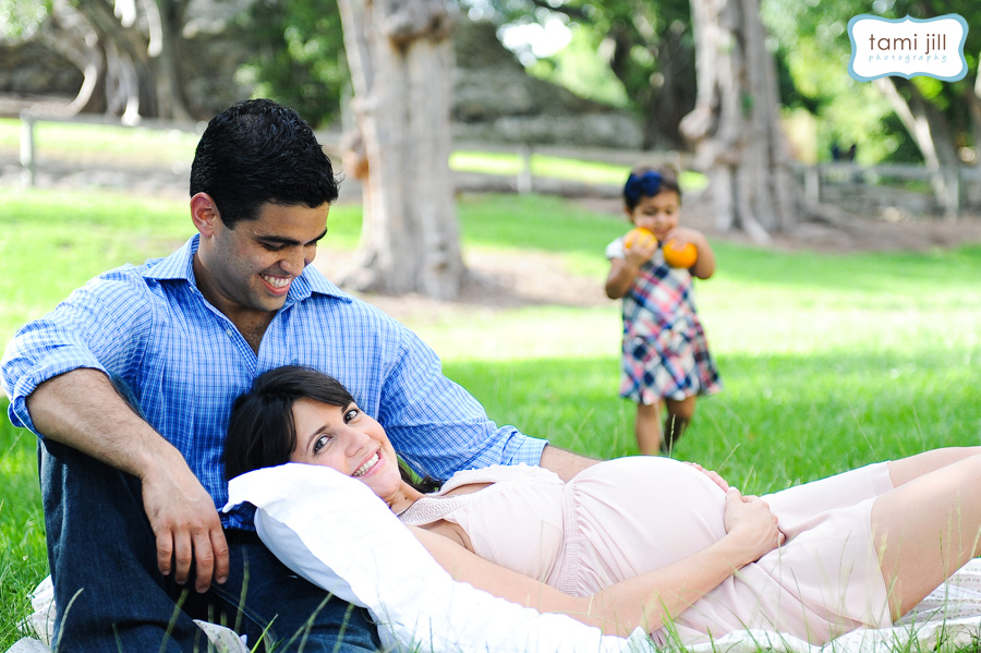 Family plays at during a Family Photography session in Miami.