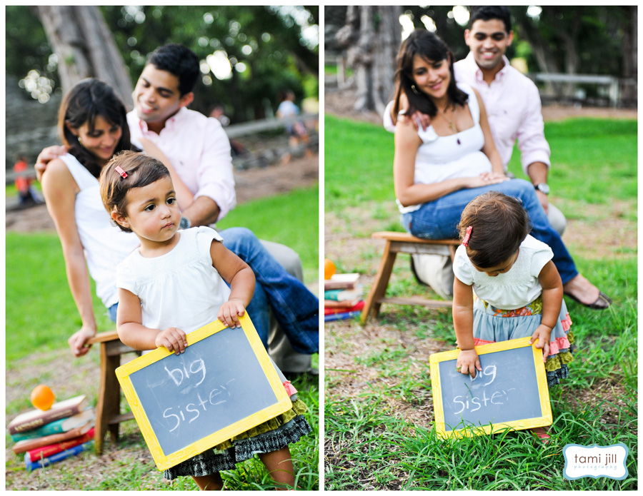 Child poses with chalkboard during a Family Photo session in Miami.