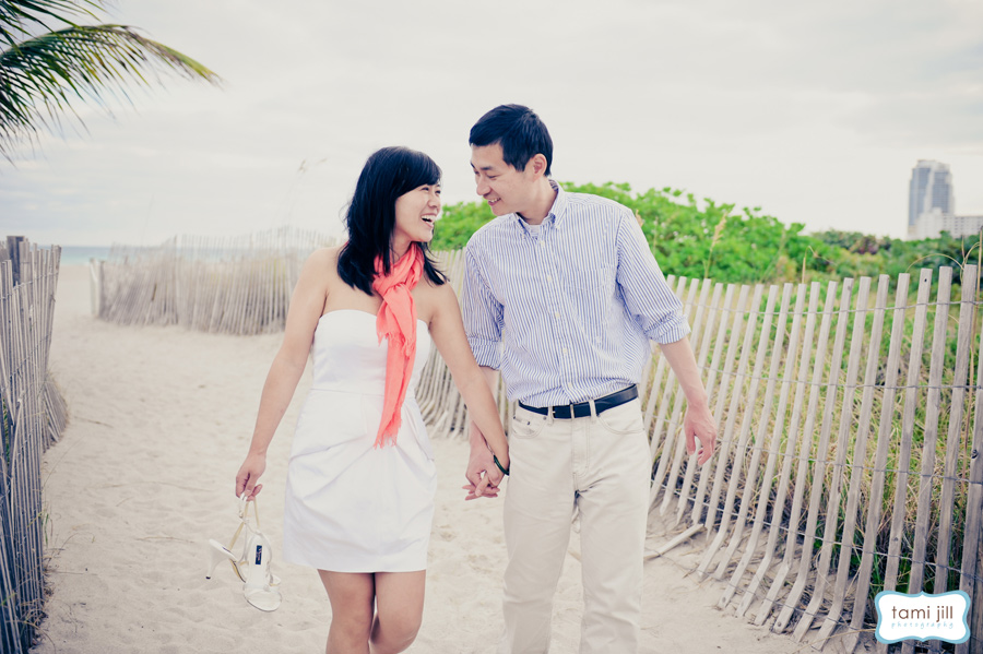 Couple walks on South Beach for engagement photo shoot.
