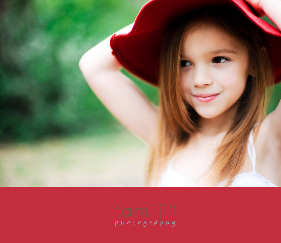 Girl wearing vintage red hat in forest.