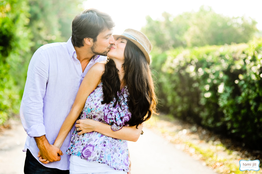 Couple kisses for the camera in a South Florida Engagement session in Davie.