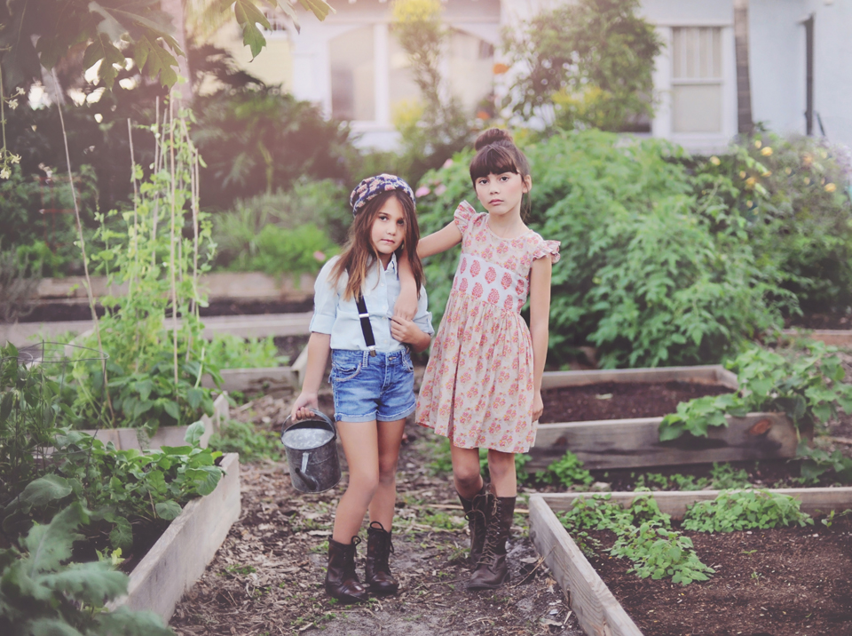 Sisters in the garden for miami child model photographer.