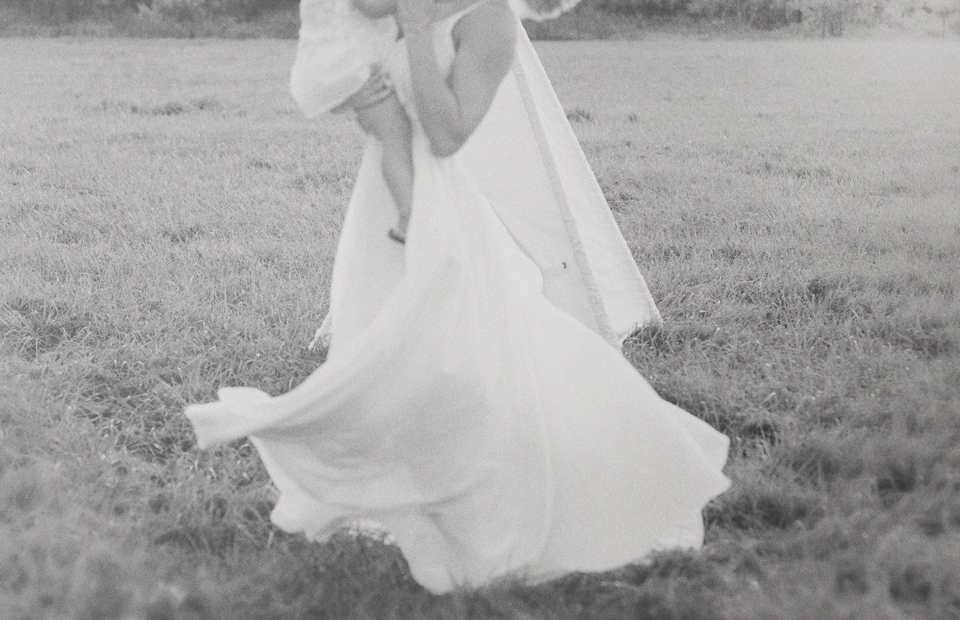 Mother twirling dress during Davie Photography session.