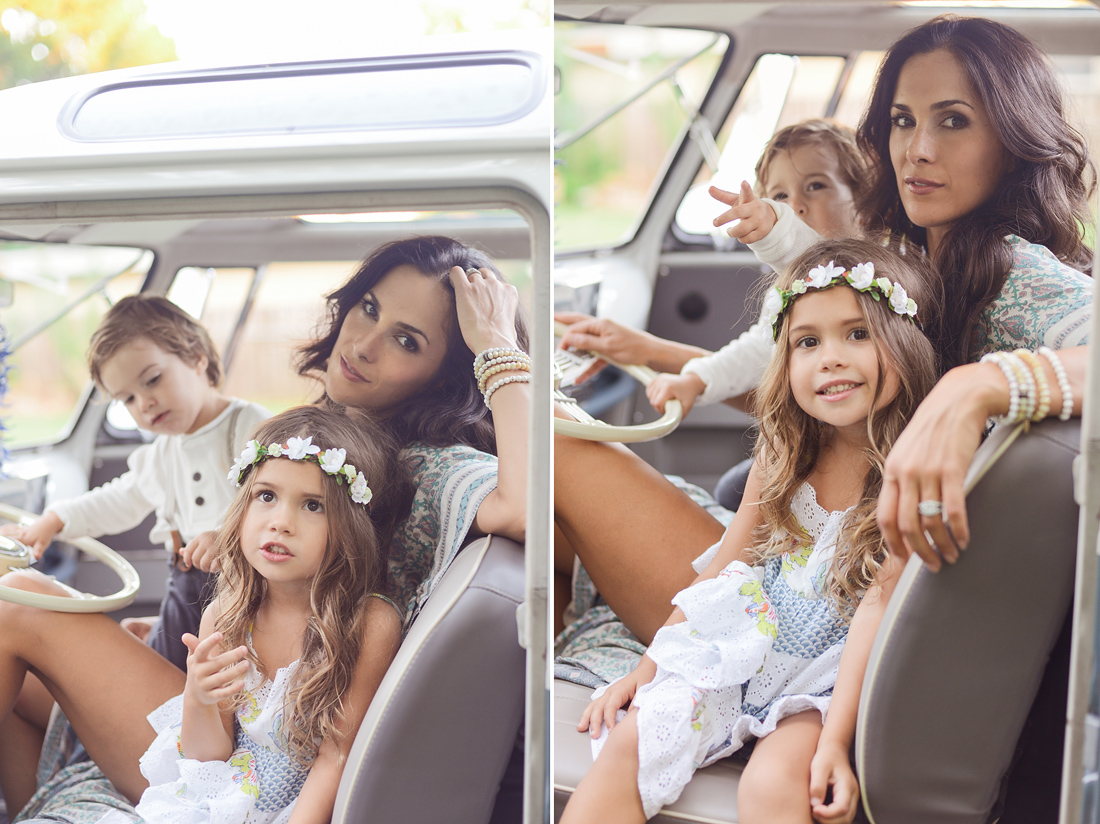 Mother poses with children in VW Bus.